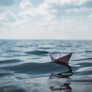 A paper boat floating on the sea