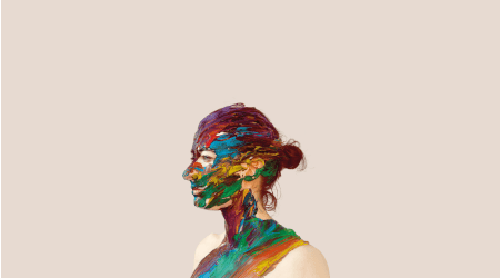 A young woman painted with bright colours