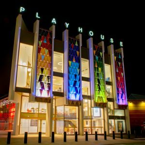 Photograph of the entrance to Leeds Playhouse at night