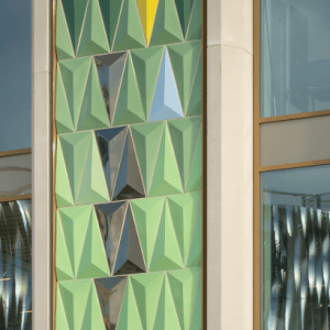 A close up image of coloured tiles on the front of the Playhouse building